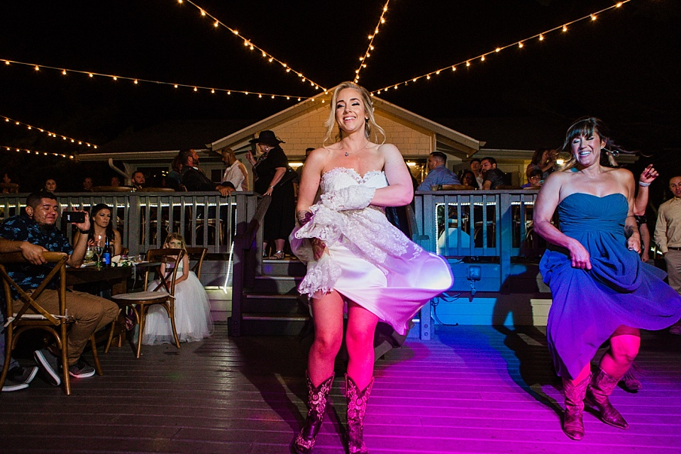 bride dancing with cowboy boots martin johnson house wedding