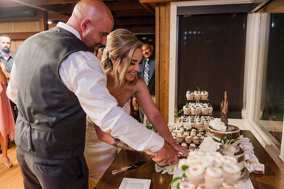 bride and groom cutting the wedding cake martin johnson house la jolla