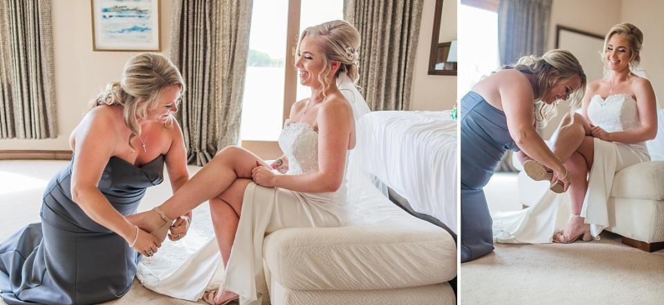 bridesmaid putting on brides shoe la jolla wedding photography