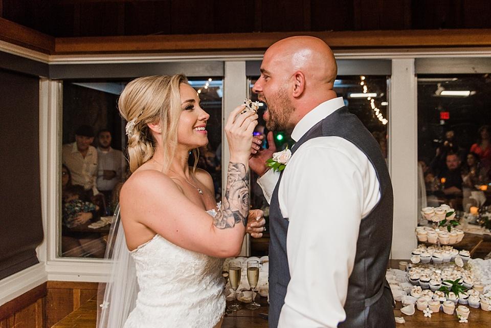 bride serving groom cake martin johnson house wedding