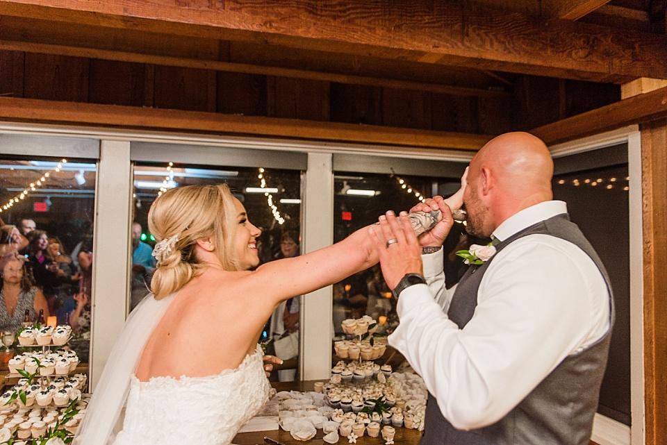bride shoving cake in grooms face la jolla wedding venues