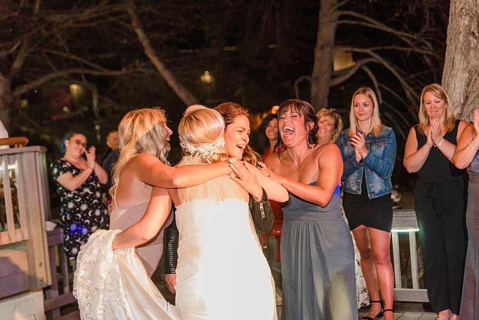 bride embracing guests at martin johnson house wedding