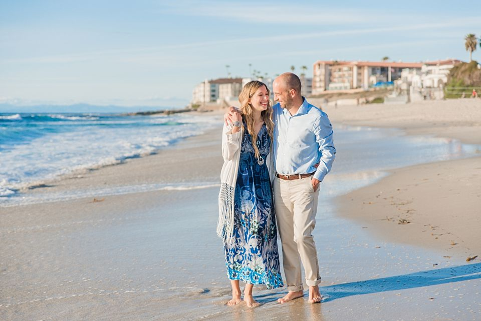couple walking on the beach san diego engagement photo locations