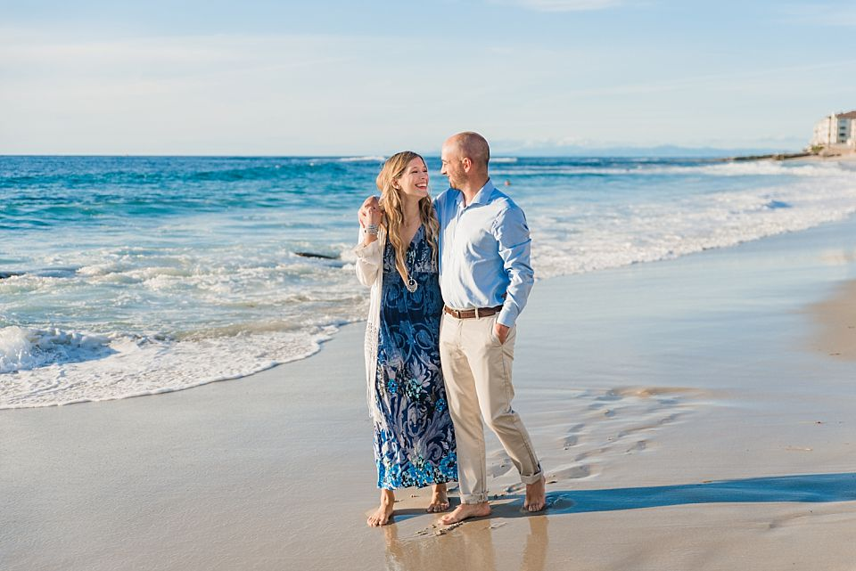engaged couple strolling on the beach la jolla engagement session