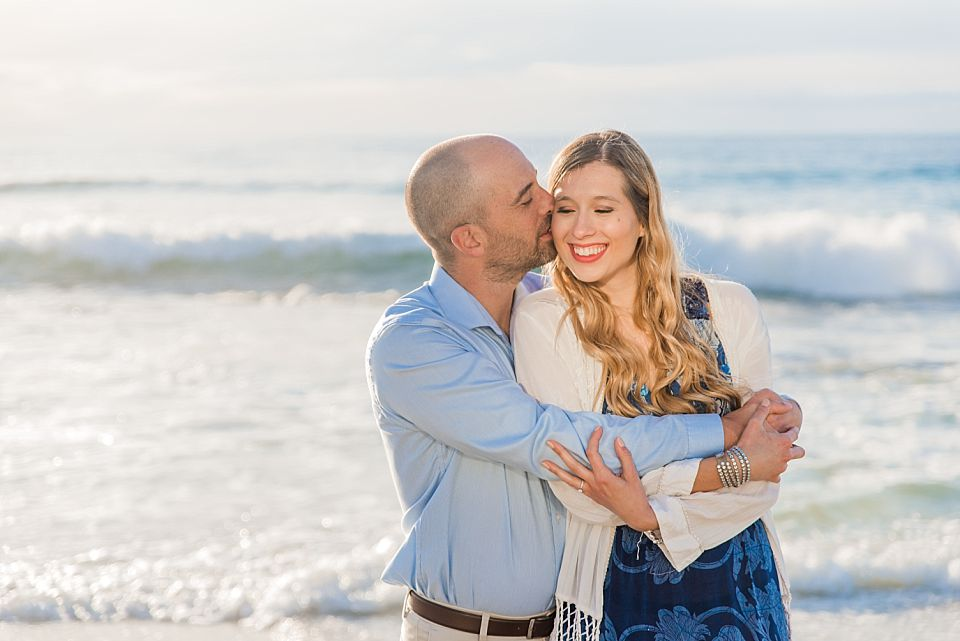 man kissing woman on the cheek san diego engagement photo ideas