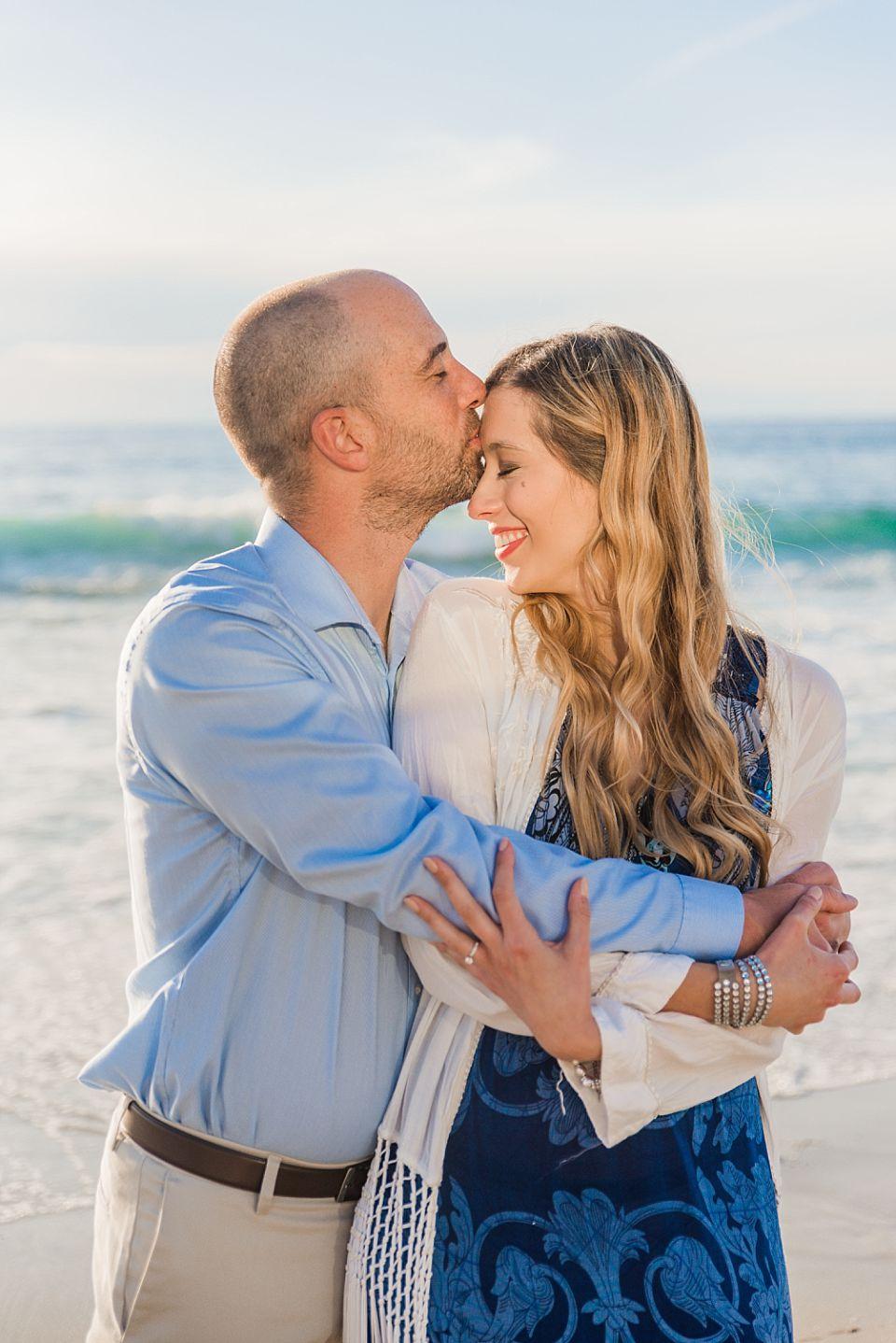 man kissing woman on forehead beach san diego wedding photographer