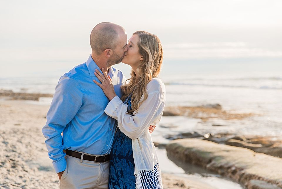 couple kissing windandsea beach engagement photos