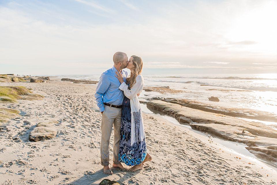 beach couple kissing la jolla engagement session