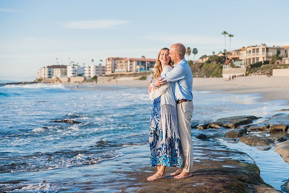 couple standing near ocean la jolla engagement photos