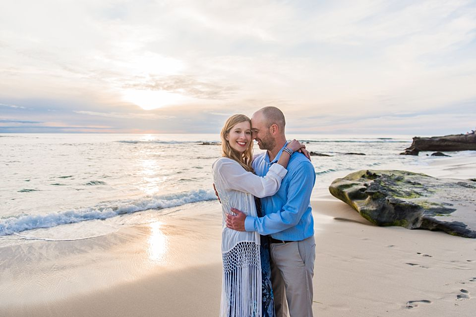couple in embrace beach san diego engagement photo ideas