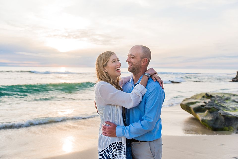couple laughing sunset san diego beach engagement photos