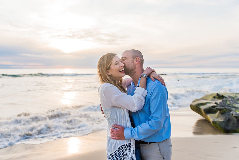 man woman beach sunset san diego engagement photographer