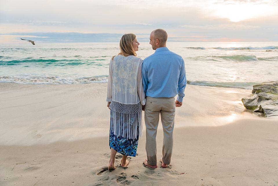 couple facing ocean windandsea beach san diego