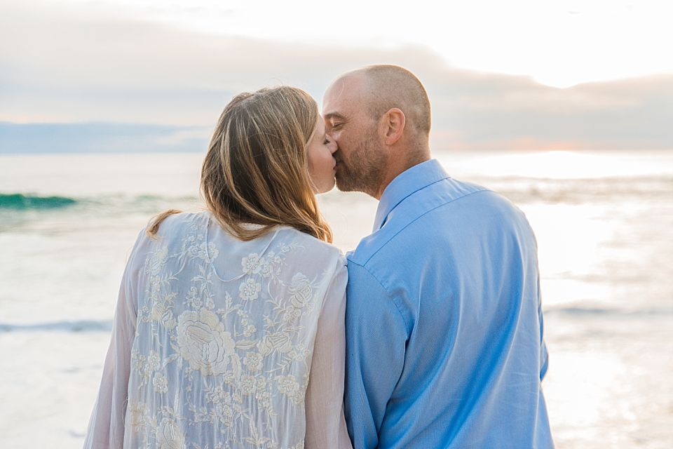 windandsea beach engagement photos couple kissing