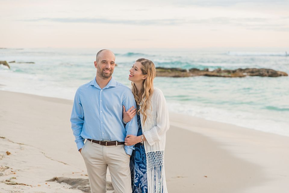 woman smiling at man la jolla engagement photos