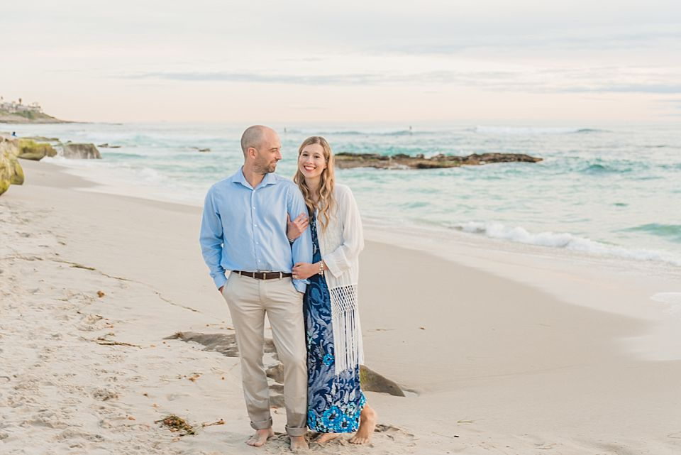 couple posing on beach san diego engagement photos