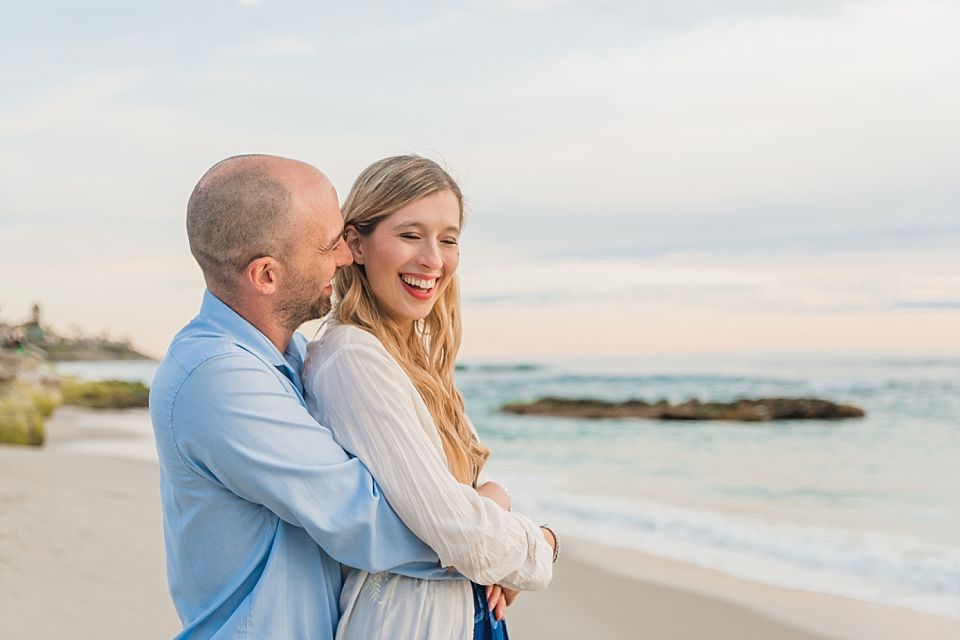 couple laughing on beach san diego engagement photo ideas