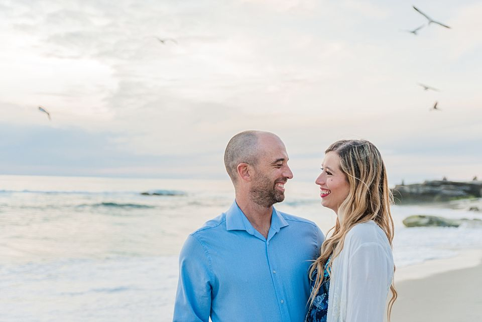 couple smiling at each other la jolla engagement photographer
