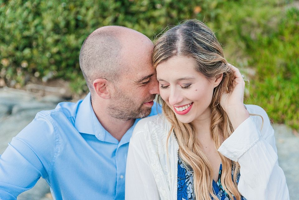 la jolla engagement session couple close together