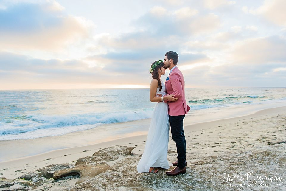 groom kissing brides forehead on the beach best place to elope san diego