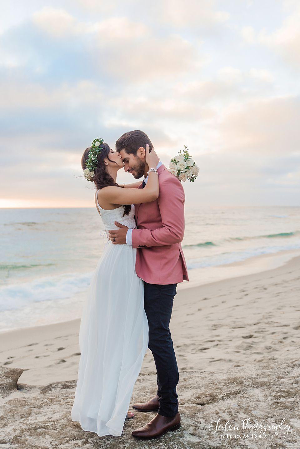 bride kissing groom on beach elope san diego