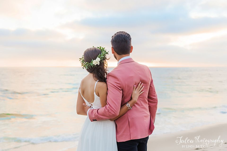 bride and groom looking at sunset san diego beach wedding