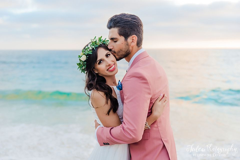 groom kissing brides temple best places to elope san diego