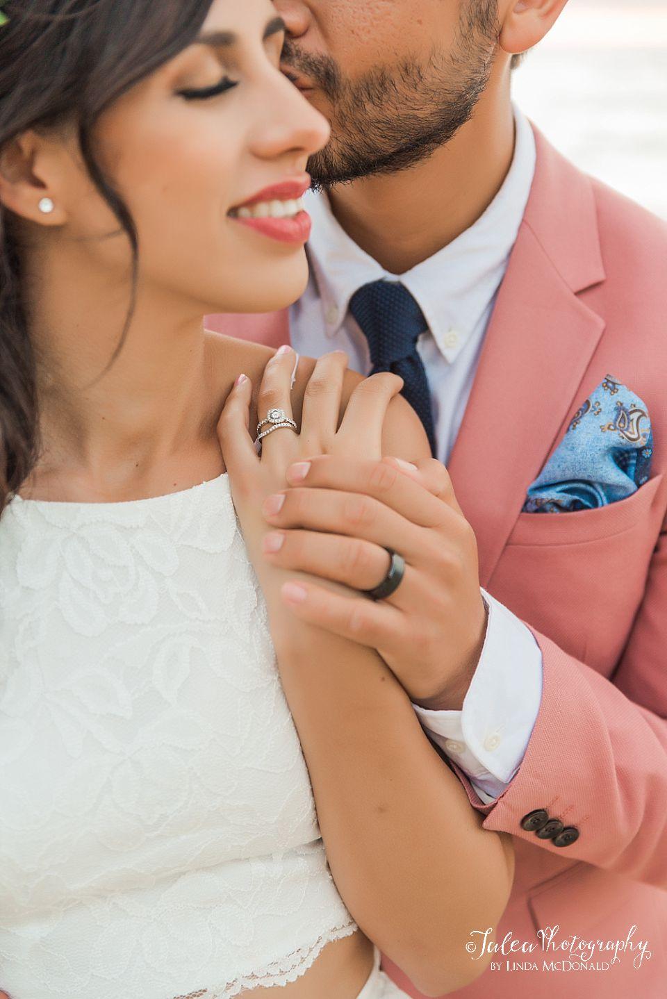 couple showing off wedding rings La Jolla California elopement