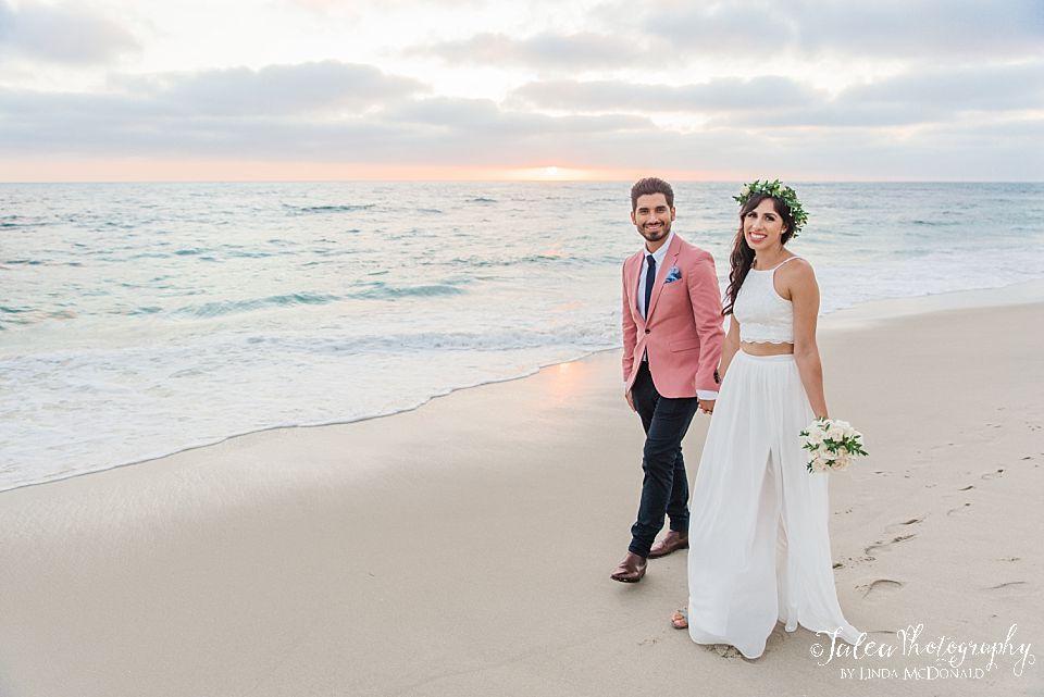 wedding couple walking on San Diego beach where to elope
