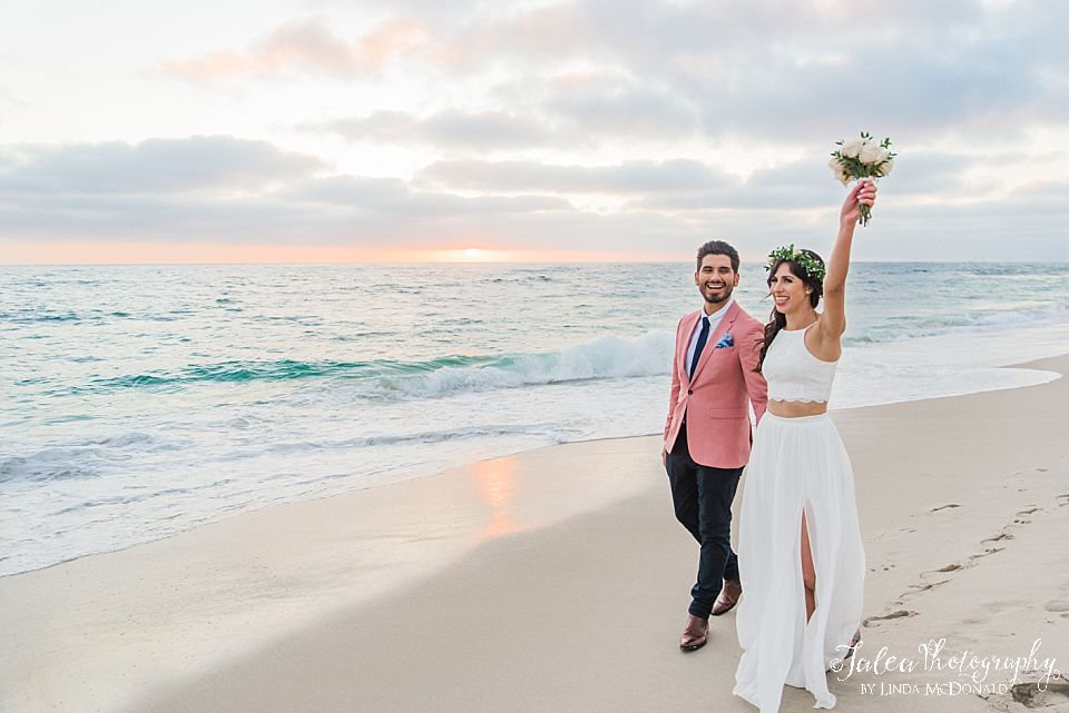 bride and groom celebrating getting married on the beach elope San Diego