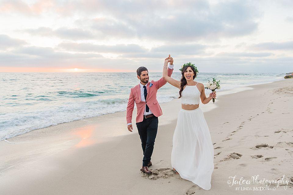 couple doing a twirl on the beach La Jolla California weddings