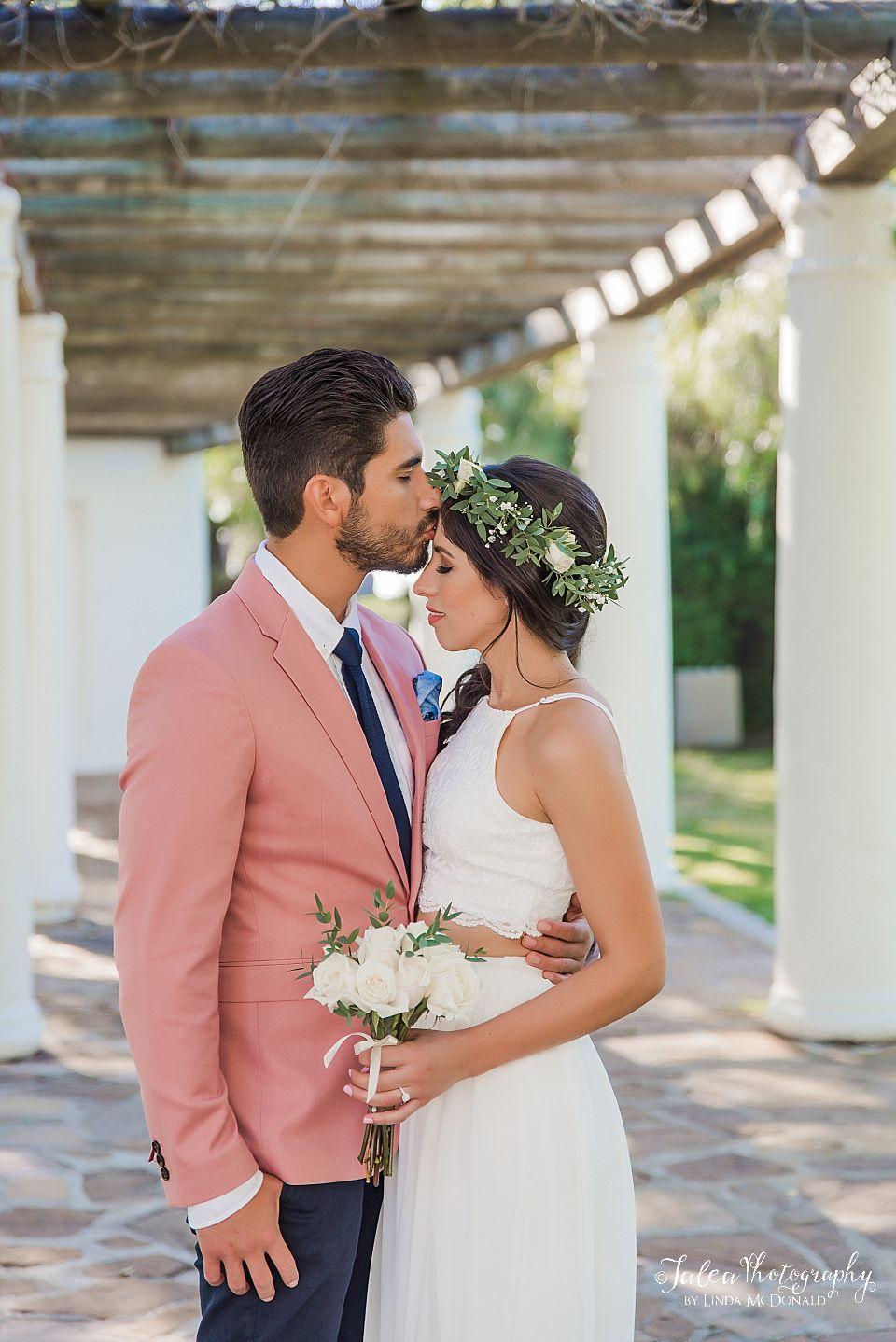 groom kissing brides forehead Presidio Park San Diego Arbor