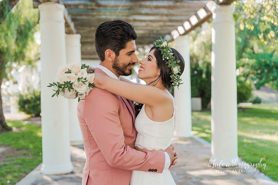 bride wraps arms around grooms shoulders elope wedding Presidio Park