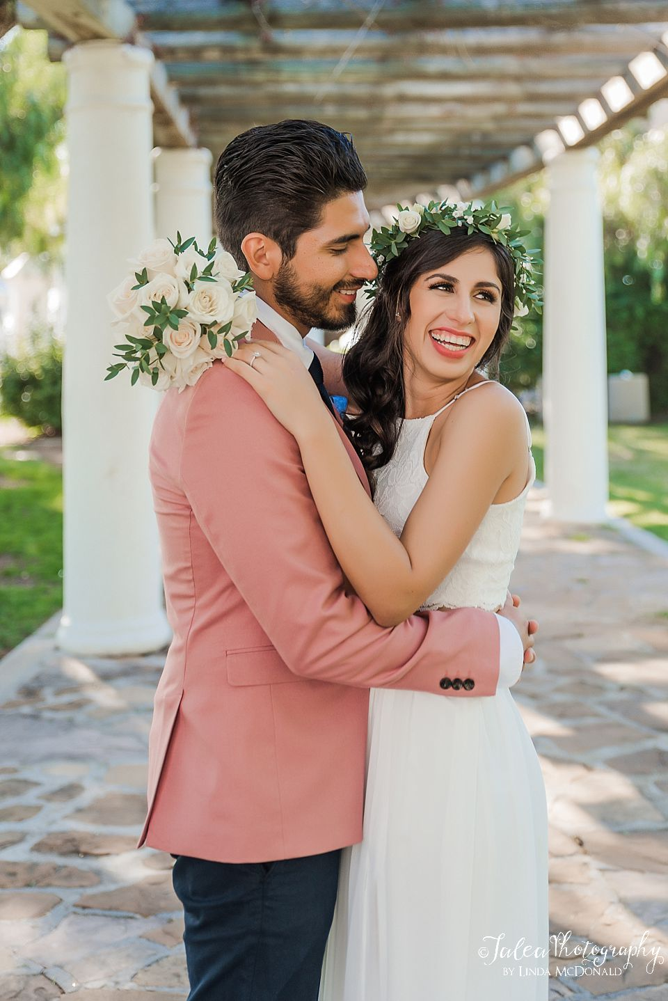 bride playfully laughing as groom looks on san diego elopement photographer