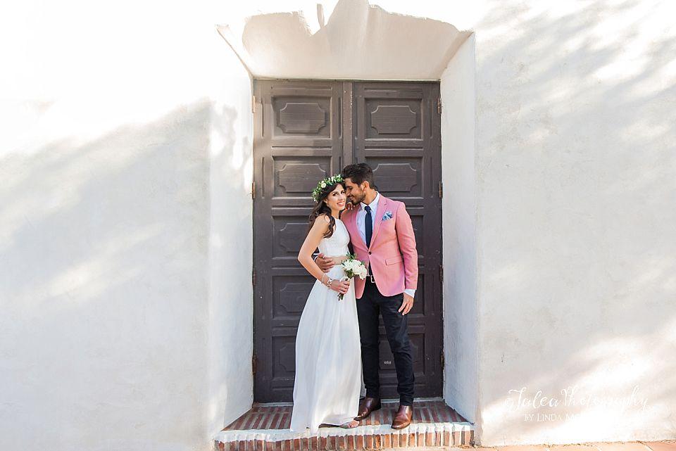 couple standing in doorway at Junipero Serra Museum Presidio Park elopement