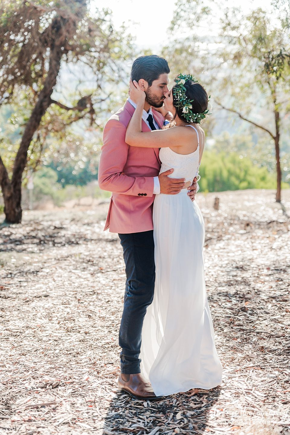 couple kissing in rustic woody area small wedding venues san diego