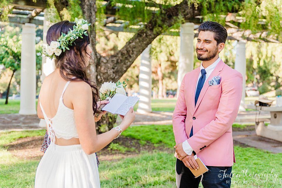 groom listening to bride read vows Presidio Park Arbor intimate elopement wedding
