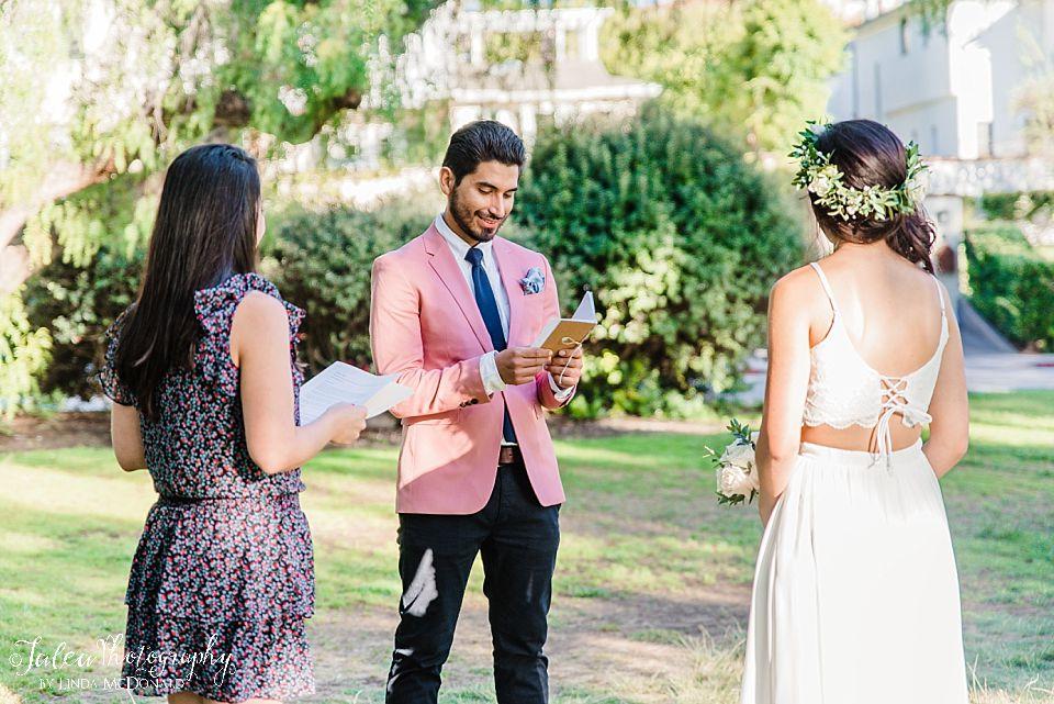 Groom readings vows to bride Presidio Park wedding elopement San Diego