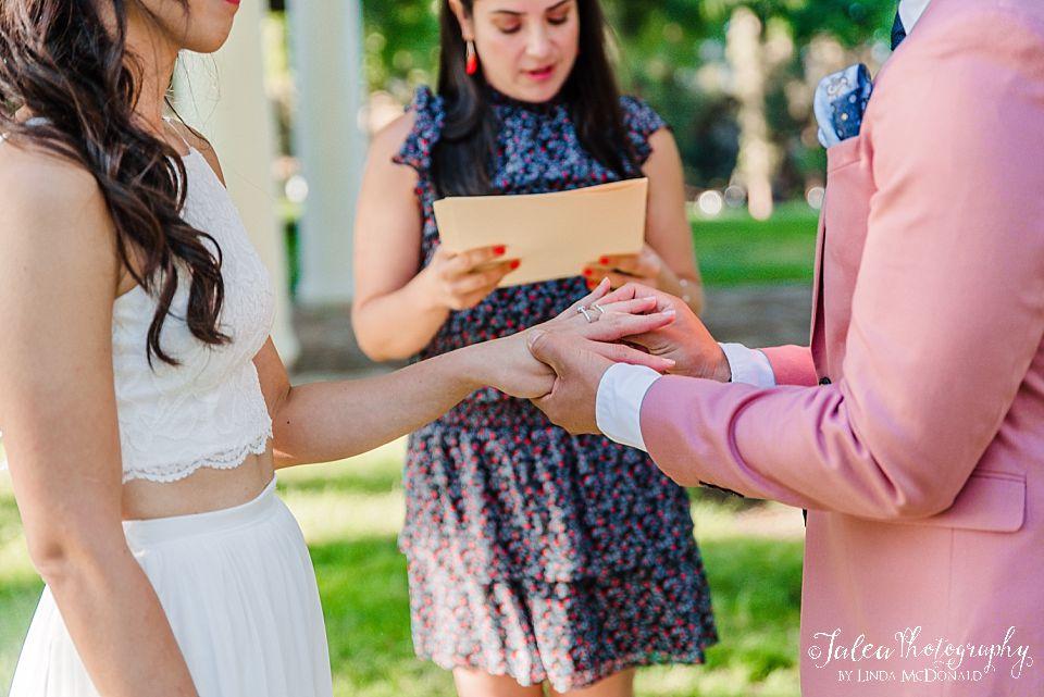 groom slipping ring on brides finger elopement ideas san diego