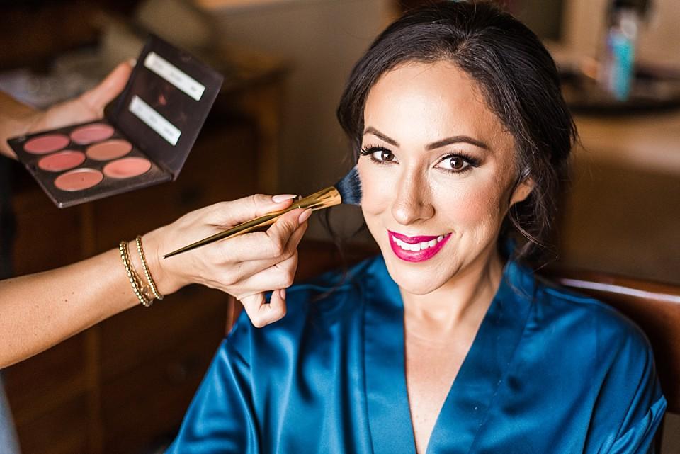 make up artist applying blush on bride Coronado wedding photographer