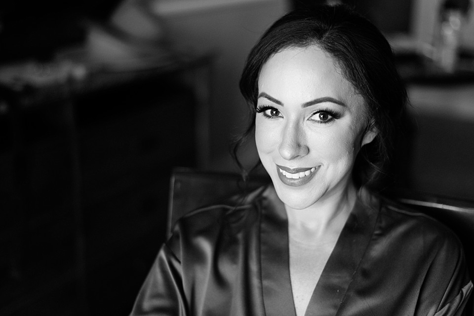 black and white portrait stunning bride make up finishing touches San Diego photographer