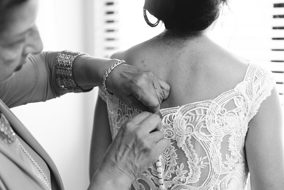 mother of the bride buttoning wedding dress Coronado hotel suite