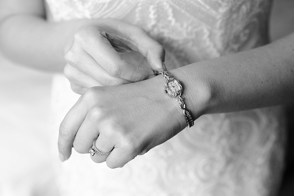 black and white image of bride putting on elegant watch Coronado wedding