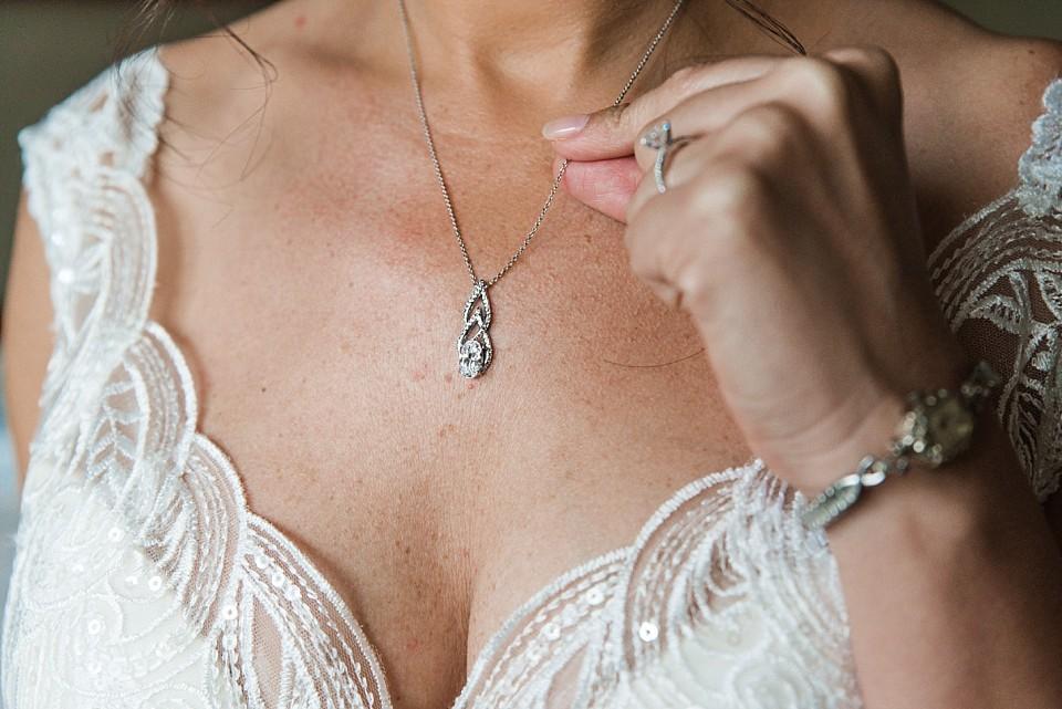 close up of bride's diamond necklace Coronado wedding