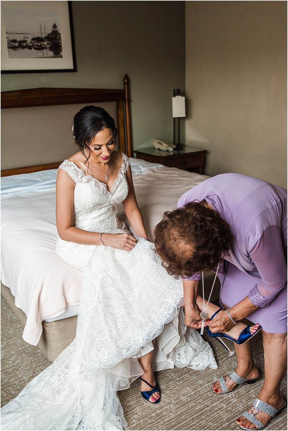 bride's mother putting on her blue wedding shoes California wedding photographer