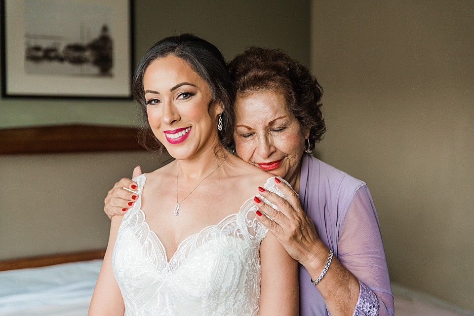 bride and mom share a special moment San Diego wedding photographer