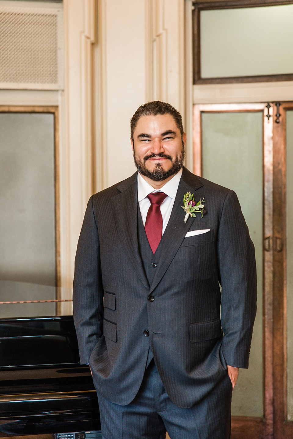 portrait of groom gray suit standing piano Glorietta Bay Inn