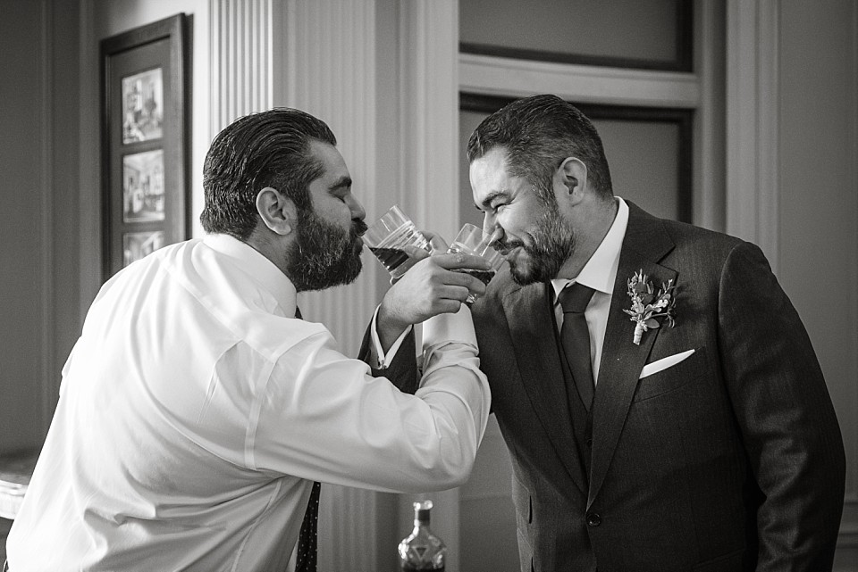 fun moment brother groom sharing celebratory drink before ceremony