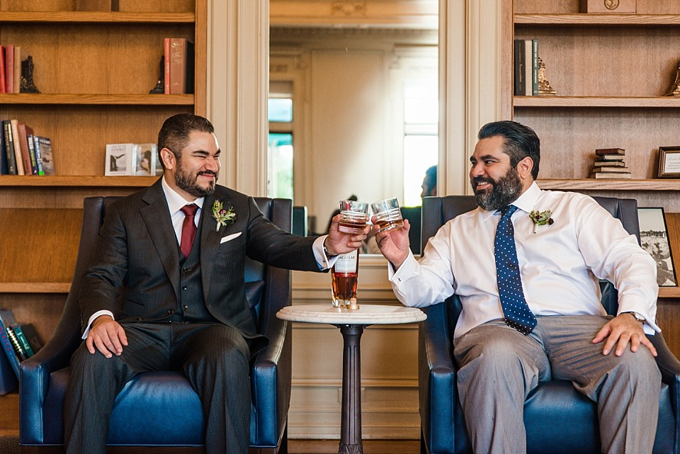 groom brother sharing a toast cheer before ceremony