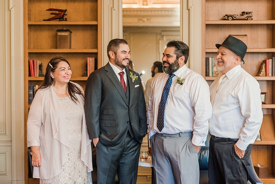 groom and family sharing special moment before the wedding